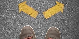 A crossroads illustrating the choice between custom built websites vs. templates | THAT Agency of West Palm Beach, FL